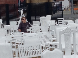 185 white chair located on a completely demolished site to signify the number of people who lost their lives in the last quake