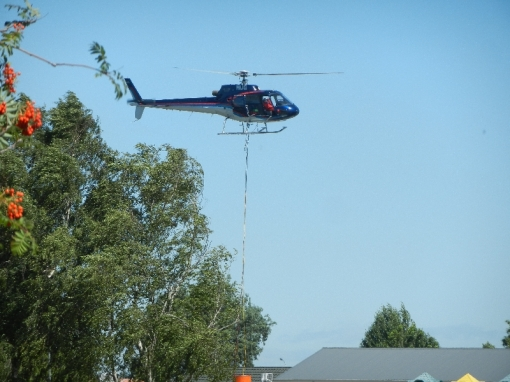 Helicopter collecting water from school swimming pool