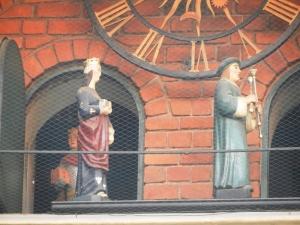 Figures of the clock at Jagiellonian University