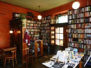 One of several rooms in the Massolit book cafe. Can you see the cache? (hint: top left)